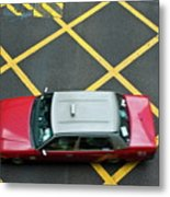 Red Taxi Cab Driving Over Yellow Lines In Hong Kong Metal Print