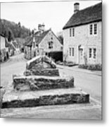 remains of the buttercross in the centre of Castle Combe village wiltshire england uk Metal Print