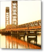 Rio Vista Bridge Sunrise Metal Print by Troy Montemayor