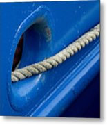 Rope Exiting Through The Bright Blue Metal Print