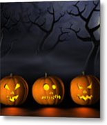 Row Of Halloween Pumpkins In A Spooky Forest At Night Metal Print