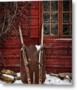 Rusty Wheelbarrow Leaning Against Barn In Winter Metal Print by Sandra Cunningham