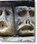 Scary Stone Heads Metal Print