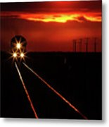 Scenic View Of An Approaching Trrain Near Sunset Metal Print