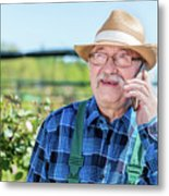 Senior Gardener Talking On The Phone With A Client. Metal Print