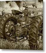 Sepia Toned Old Farmall Tractor In A Grassy Field Metal Print