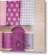 Sewing Threads Needle And Fabrics On A Wooden Box Metal Print