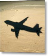Shadow Of Airplane Flying Into Land Metal Print