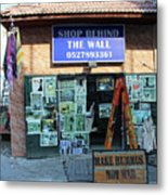 Shop Behind The Wall Metal Print