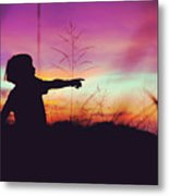 Silhouette Of A Playful Boy Pointing With Finger In The Field During Beautiful Sunset Metal Print