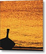 Silhouette Of A Thai Wooden Boat  On The Beach Against Golden Sunset Koh Lanta, Thailand Metal Print