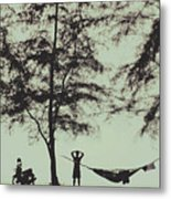 Silhouette Of A Young Men With Crossed Hands Above His Head Camping Hammocking In The Nature Metal Print
