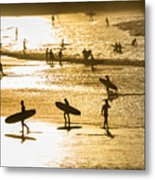 Silhouette Of Surfers At Sunset Metal Print