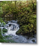 Small River Cascade Over Mossy Rocks In Northern Wales Metal Print