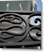 Snakes On A Gate Metal Print