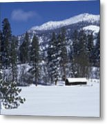 Snow Covered Trees And Cabin At Rock Metal Print