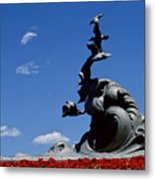 Statue And Tulips Against A Clear Blue Metal Print