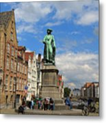 Statue Of Jan Van Eyck Beside The Spieglerei Canal In Bruges Metal Print