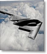 Stealth Bomber Over The Clouds Metal Print