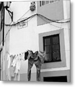 street in Porto with hanging clothes Metal Print