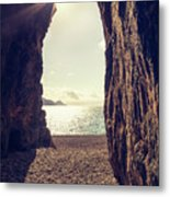 Sun Glinting Through A Cave At Bussaglia Beach In Corsica Metal Print