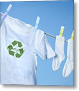 T-shirt With Recycle Logo Drying On Clothesline On A  Summer Day Metal Print