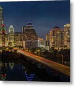 The Glimmering Neon Lights Of The Downtown Austin Skyscrapers Illuminate The Skyline Over Lady Bird Lake Metal Print