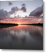 The Missouri River At Sunset Reflects Metal Print