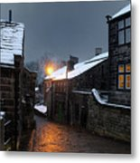 The Village Of Heptonstall In The Snow At Night With Lamps Shini Metal Print
