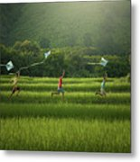 Three Boys Are Happy To Play Kites At Summer Field In Nature In  Metal Print