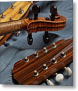 Three Musical Instrument Heads on Blue Metal Print