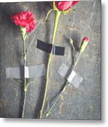 Three Red Flowers Taped To Wooden Background Metal Print