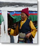 Tibetan Grandmother Turning The Prayer Wheel Metal Print