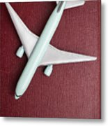 Toy Airplane Over Red Book Cover Metal Print
