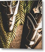 Tribal Masks With Ferns On Wooden Table Metal Print