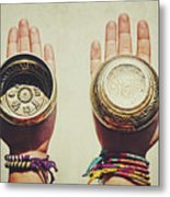 Two Hands Holding And Showing Both Sides Of Decorated Tibetan Singing Bowls Metal Print