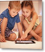 Two Happy Children Playing On The Tablet Metal Print