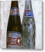 Two Pepsi Bottles On A Table Metal Print by Daniel Hagerman