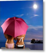 Two Women Relaxing On A Shore Metal Print