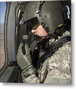 Uh-60 Black Hawk Crew Chief Looking Metal Print