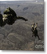 U.s. Army Soldiers Conduct A Halo Jump Metal Print