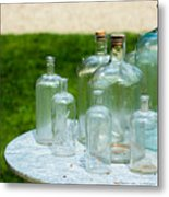 Vintage Glass Bottles On Table Metal Print