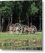 Wagon Wheels Reflecting In A Pond Metal Print