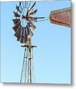 Water Pump Windmill On Blue Sky Background Metal Print