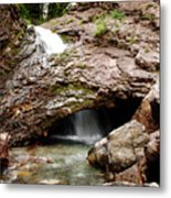 Waterfall Into A Cave Metal Print