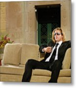 Wealthy Young Man In Suit Sitting On A Couch With A Drink On A T Metal Print