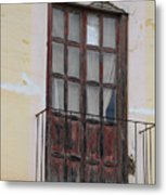 Weathered Red Door On A Balcony Metal Print