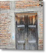 Weathered Wood Door In An Adobe Brick Wall Metal Print