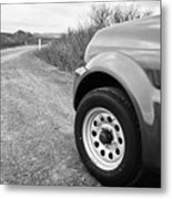 Wheel Of Small 4x4 Vehicle Driving On Gravel Road Onto Main Road Reykjavik Iceland Metal Print