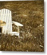 White Chair With Straw Hat In A Field Metal Print